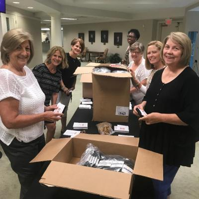 SLBC Women's Ministry volunteers prepare Bombas socks with human trafficking information