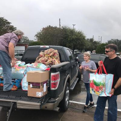 Cathy & Eric Carter (Houston First Baptist-Sienna) help fill the truck so two young ladies have a very special Christmas!