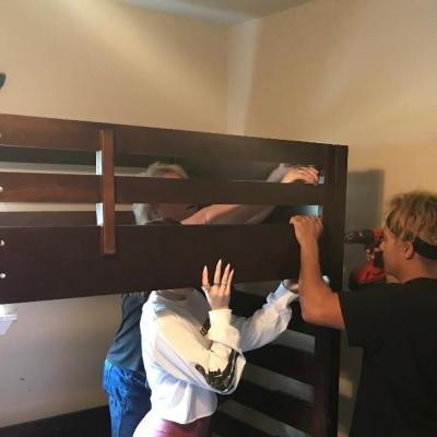 Assembling bunkbeds for children in need
