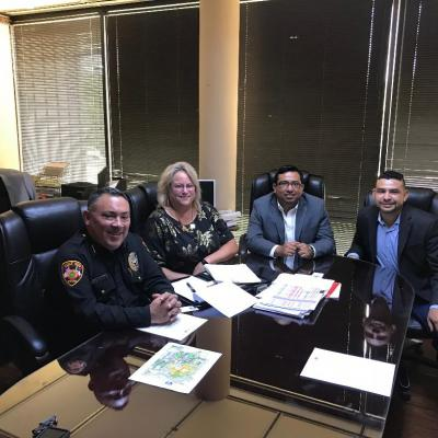 Lupe Negrete & Cynthia Aulds with Eagle Pass Police Chief A. Guajardo & Asst. City Mgr. Ivan Morua